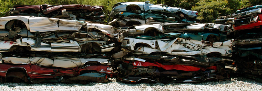 Scrap cars crushed and stacked.